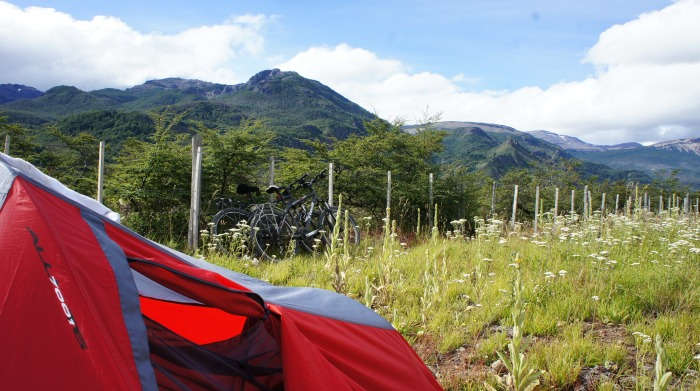 Tent with mountains and bikes in the background