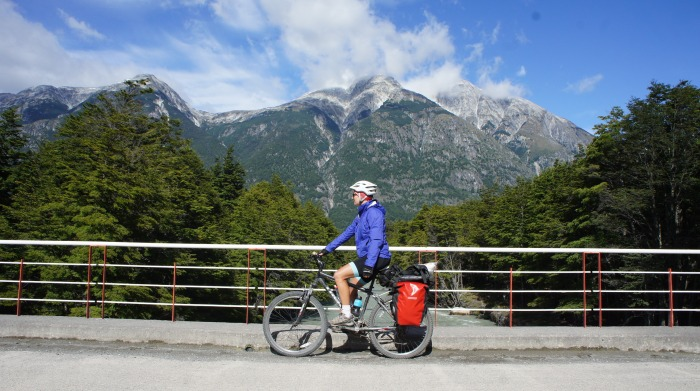 Cyclist in front of mountains