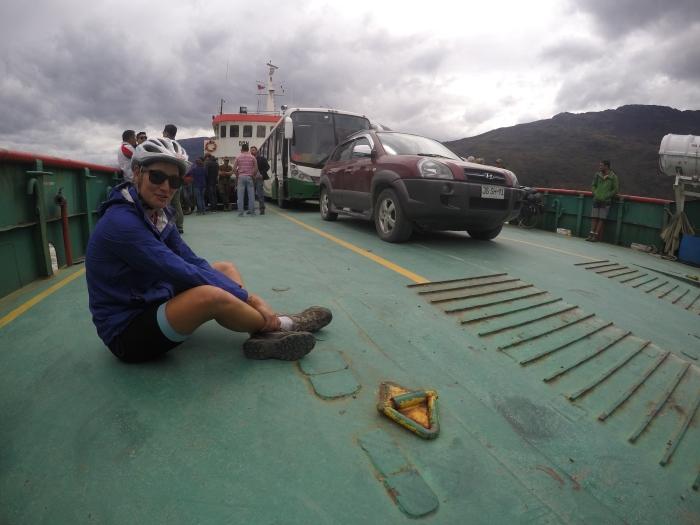 Cyclist sat on deck of car ferry